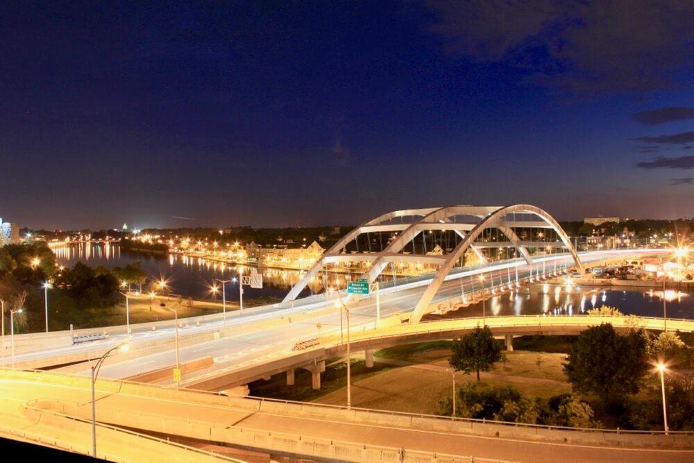 Night shot of Frederick Douglass Susan B. Anthony Bridge from Capron Lofts