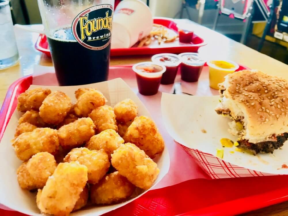 Tater tots, beer, and burger at Swillburger