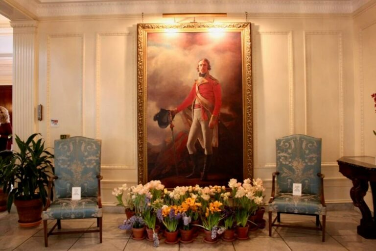 Flowers in front of a painting